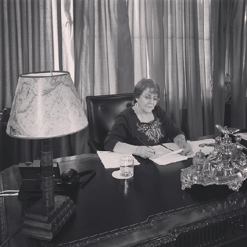 Bachelet in front of her desk, on Instagram